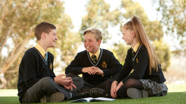 Middle School students studying outdoors